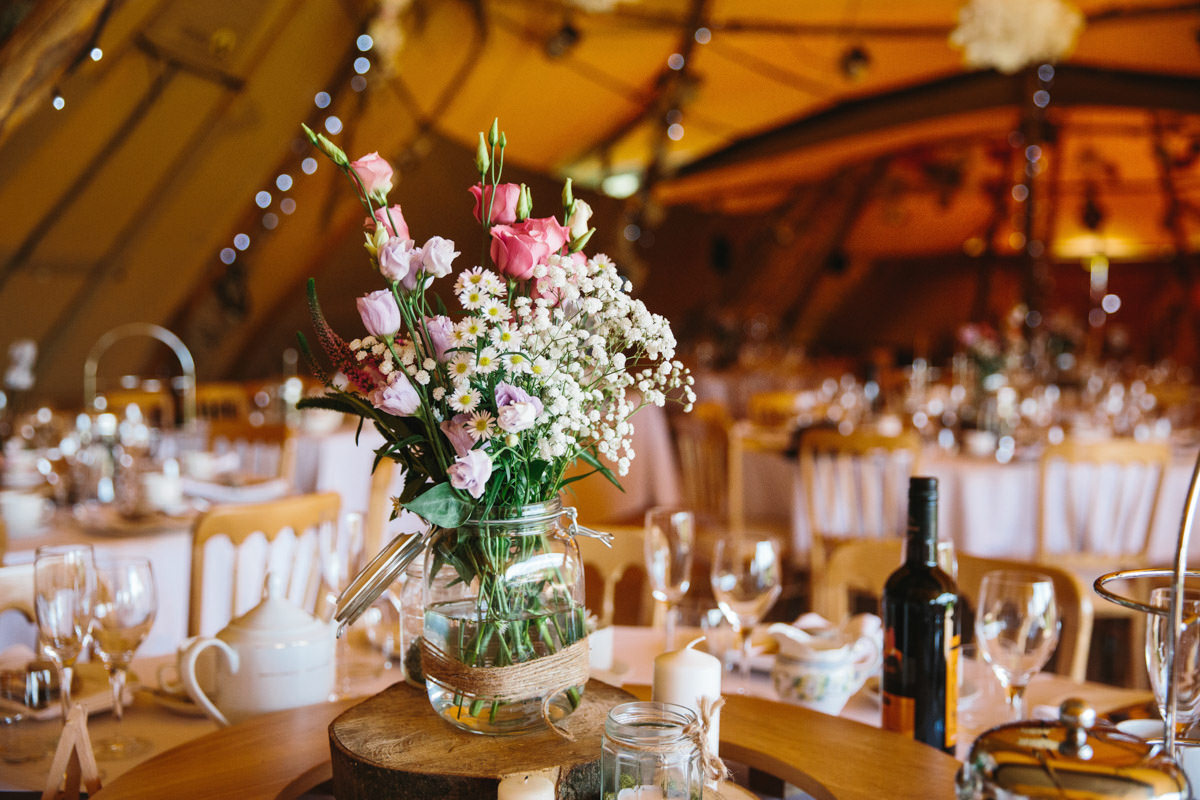 Tipi, wedding centre pieces, flowers in jars