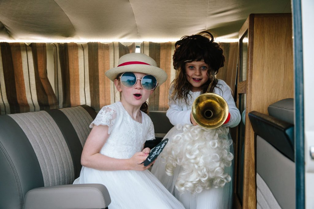 Two girls dressed up in photo booth props at a wedding