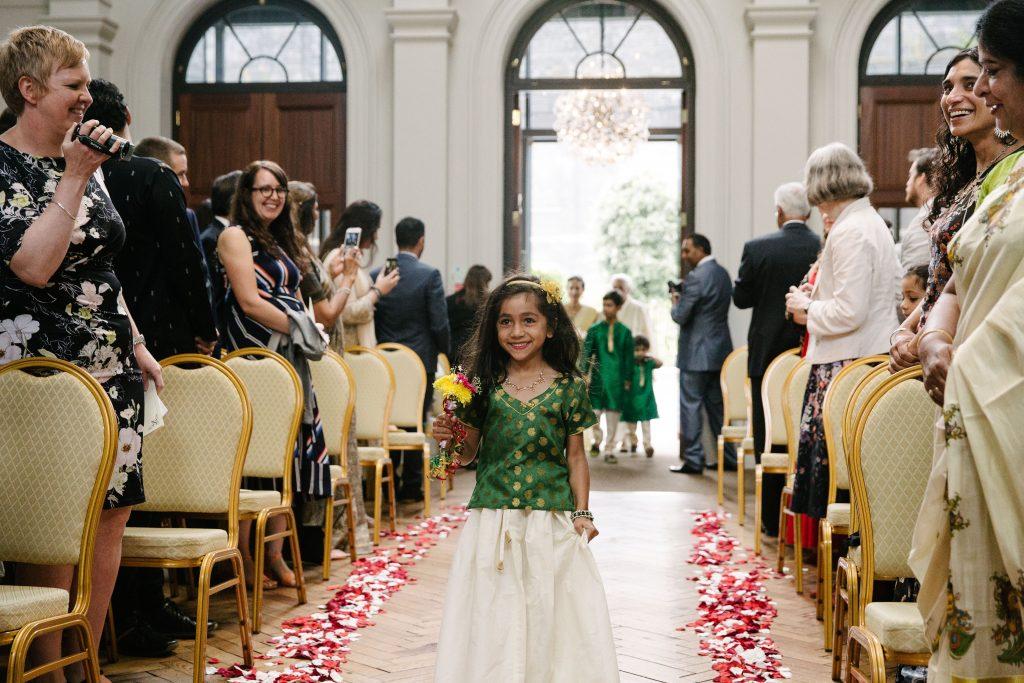 Flowergirl walking up the aisle
