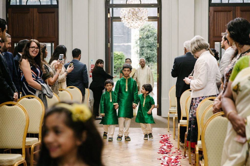 Page boys walking up the aisle