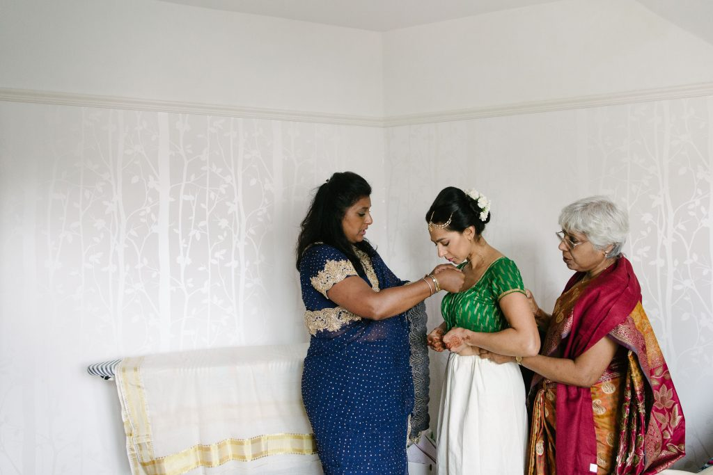 bride getting ready for wedding in indian dress