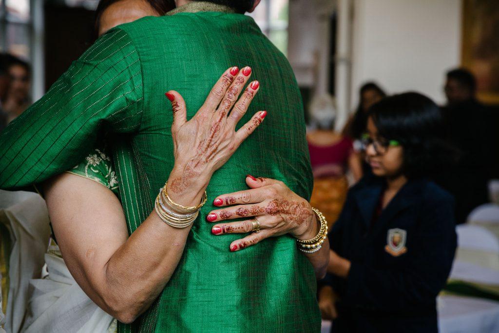 Mother of the bride hugging the groom, Wedding, Wolverhampton Grammar school