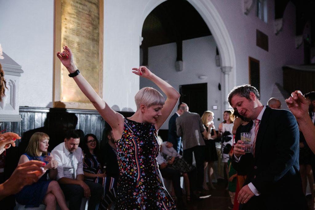 Guest dancing at wedding