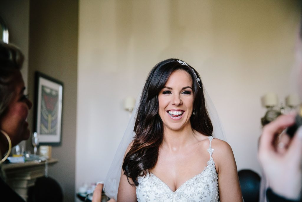 Bride smiling, ready for her wedding at Walton Hall