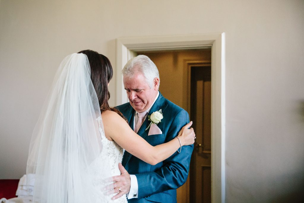 Dad getting emotional as he sees his daughter ready for her wedding
