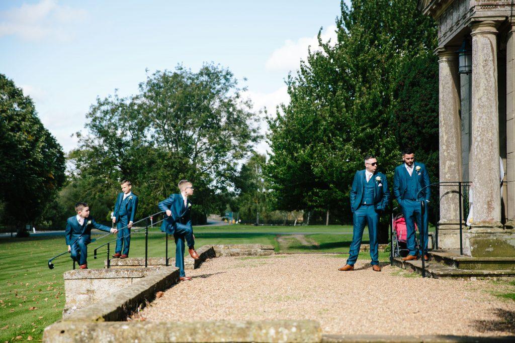 Groomsmen waiting outside before start of wedding ceremony at Walton Hall