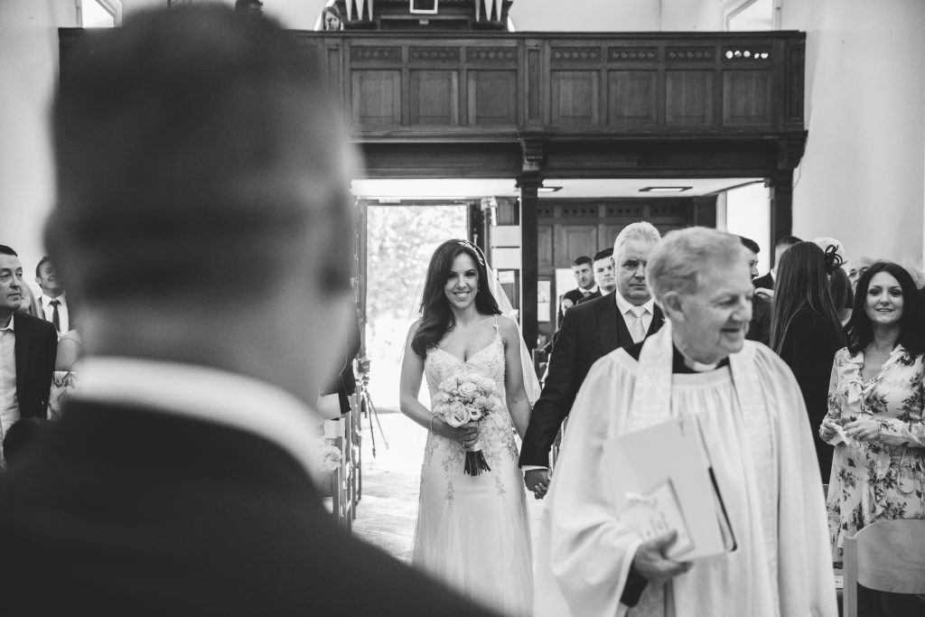 Bride walking down the aisle with her Dad at Walton Hall