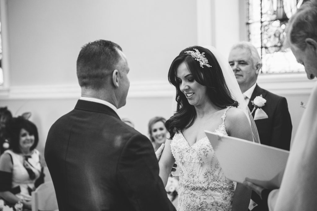 BRide getting emotional during ceremony at Walton Hall