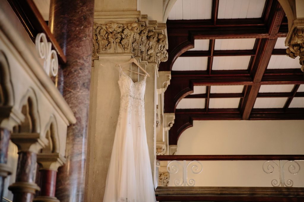 Wedding dress hanging in Walton Hall
