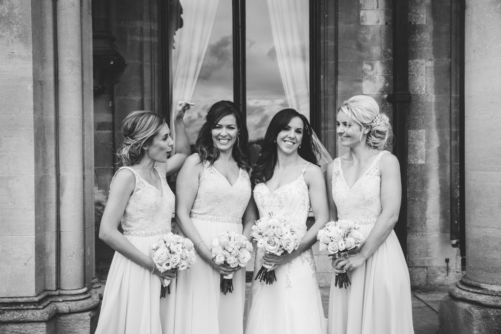 black & white image of bride with her bridesmaids