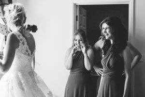 Bridesmaids looking at Bride in her wedding dress