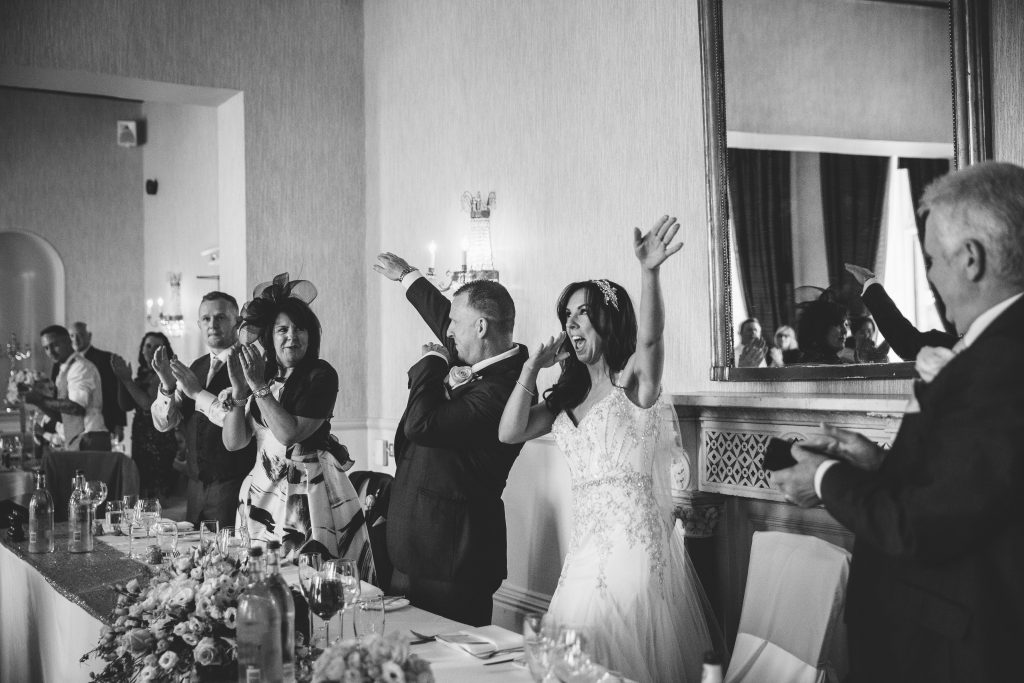 Bride & Groom doing a dab as they sit down for wedding breakfast