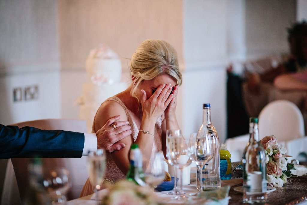 Bridesmaid getting emotional during speeches at wedding