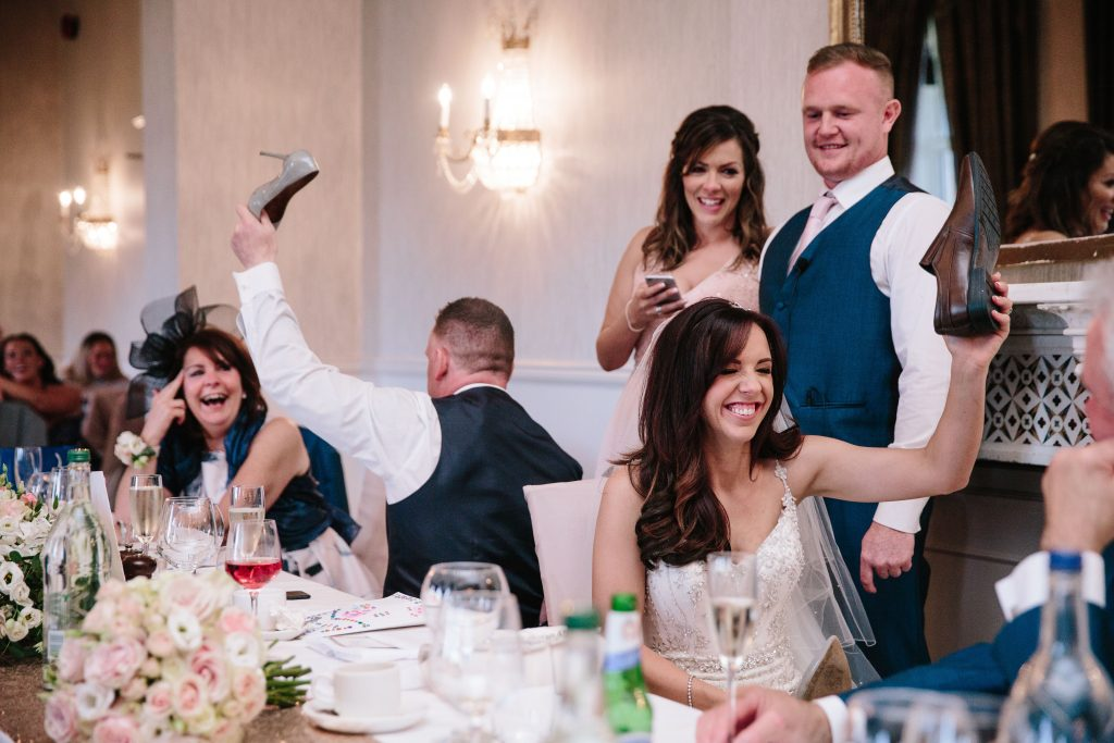 Bride & Groom playing Mr & Mrs game during wedding speeches