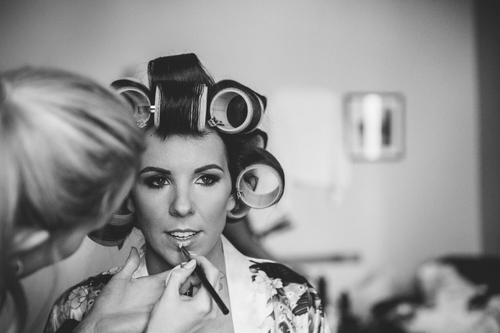 Bride having her make up done for her wedding at Walton Hall