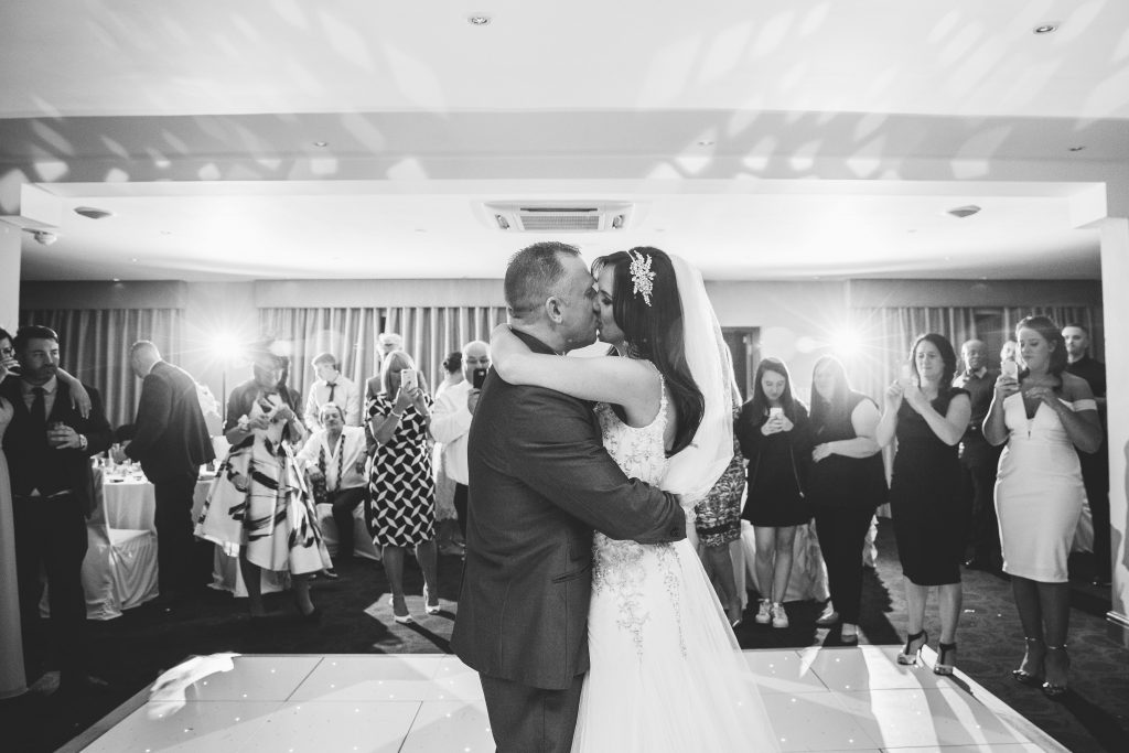 Black & white image of bride and groom dancing their first dance at Walton Hall