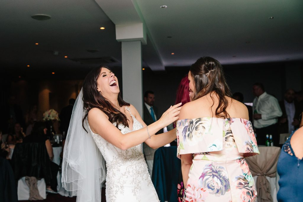 Bride laughing on the dance floor at Walton Hall