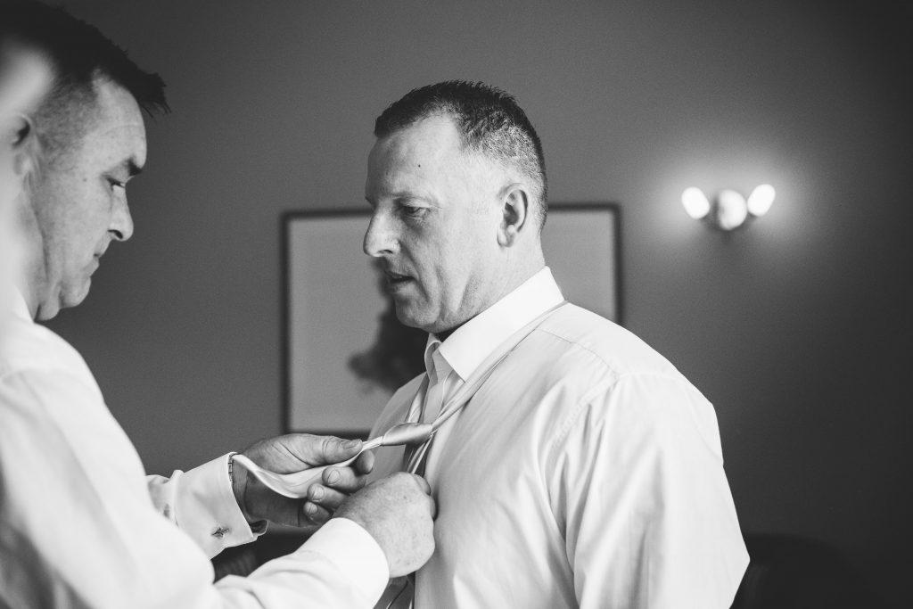 Groom getting ready for wedding at Walton Hall