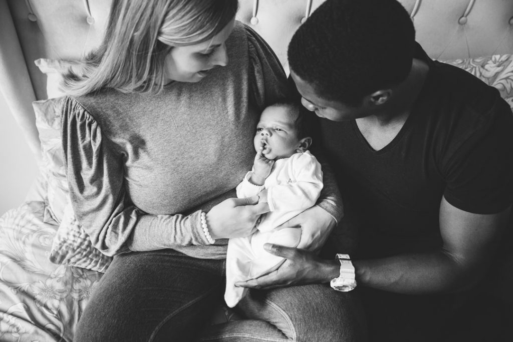 Mum and Dad holding newborn baby