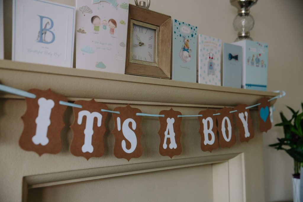 It's a boy bunting hanging from mantlepiece