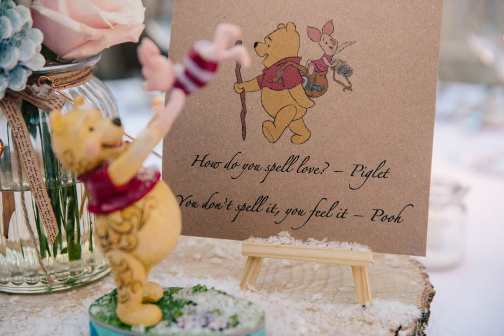 Wedding centrepiece at Hampton Manor wedding- quote from Winnie the Pooh