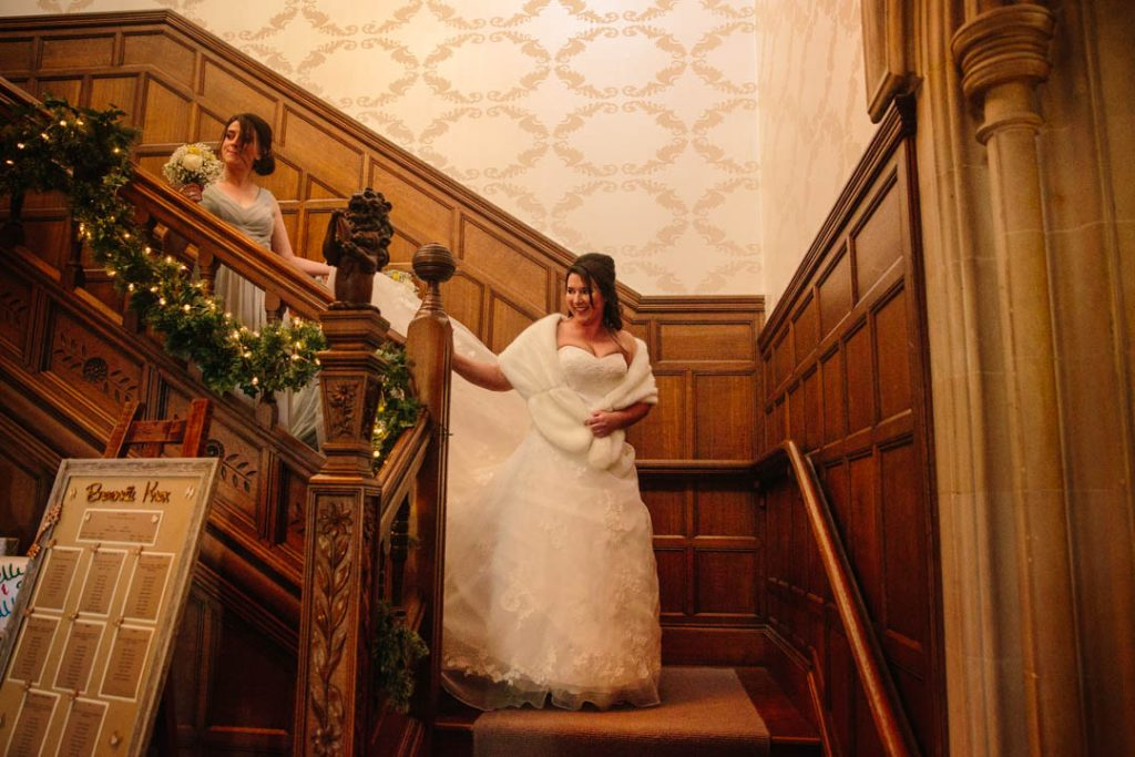 Bride walking down the stairs at Hampton Manor