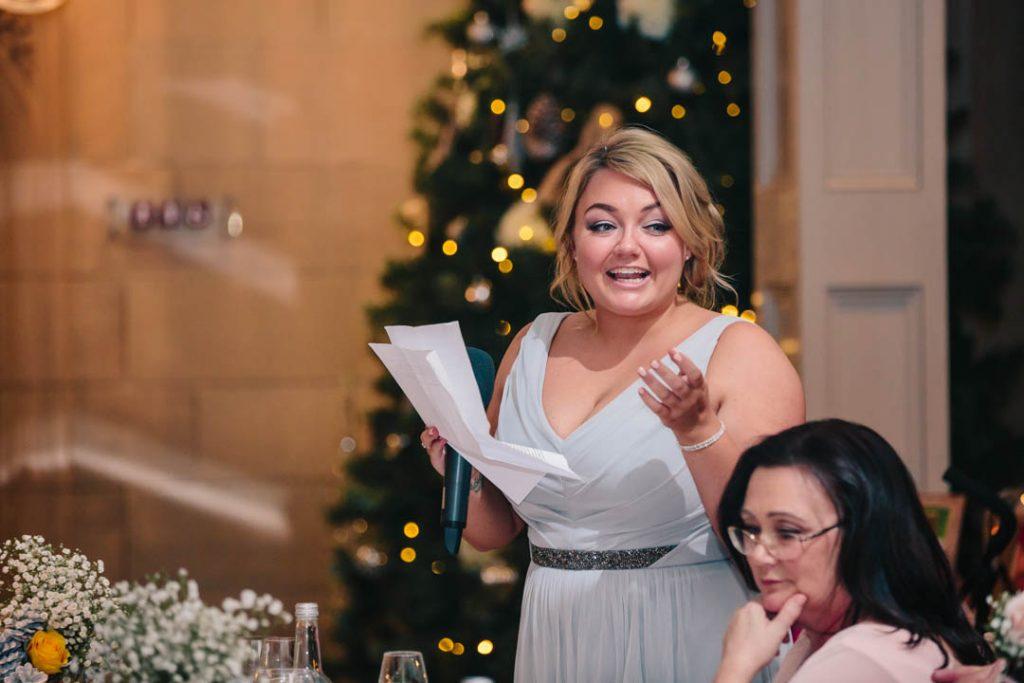 Bridesmaid giving speech at wedding at Hampton Manor