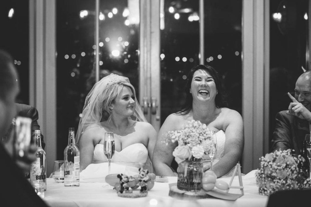Bride & Bride laughing during speeches