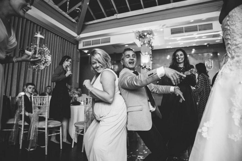 Guests dancing and laughing at a wedding at Hampton Manor