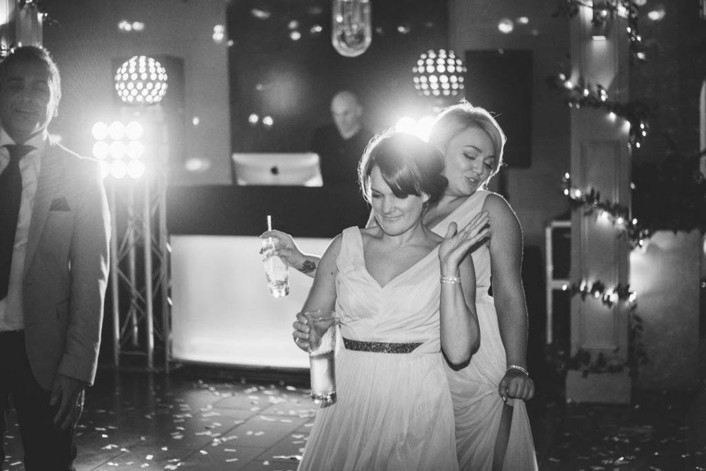 Bridesmaids dancing and drinking at a wedding at Hampton Manor
