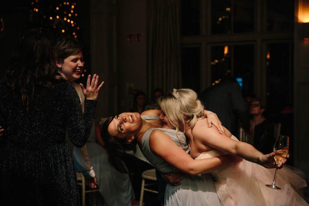 The Bride and bridesmaid drunken dancing at a wedding at Hampton Manor