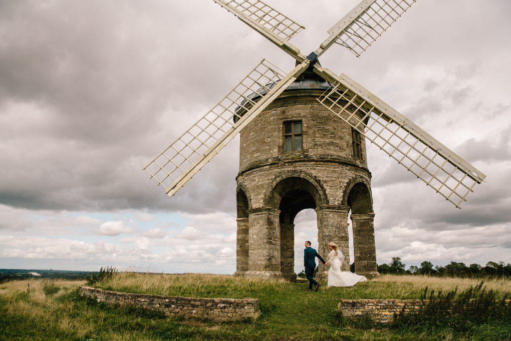 Bride & Groom walking next to Windmill