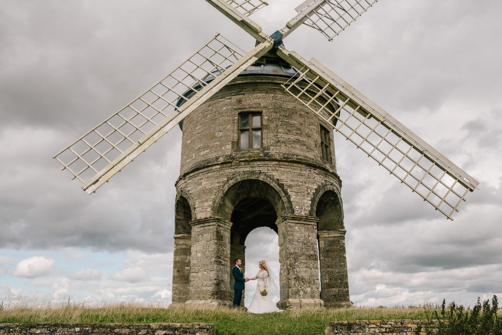 Bride & Groom standing at the foot of Chesterton windmill