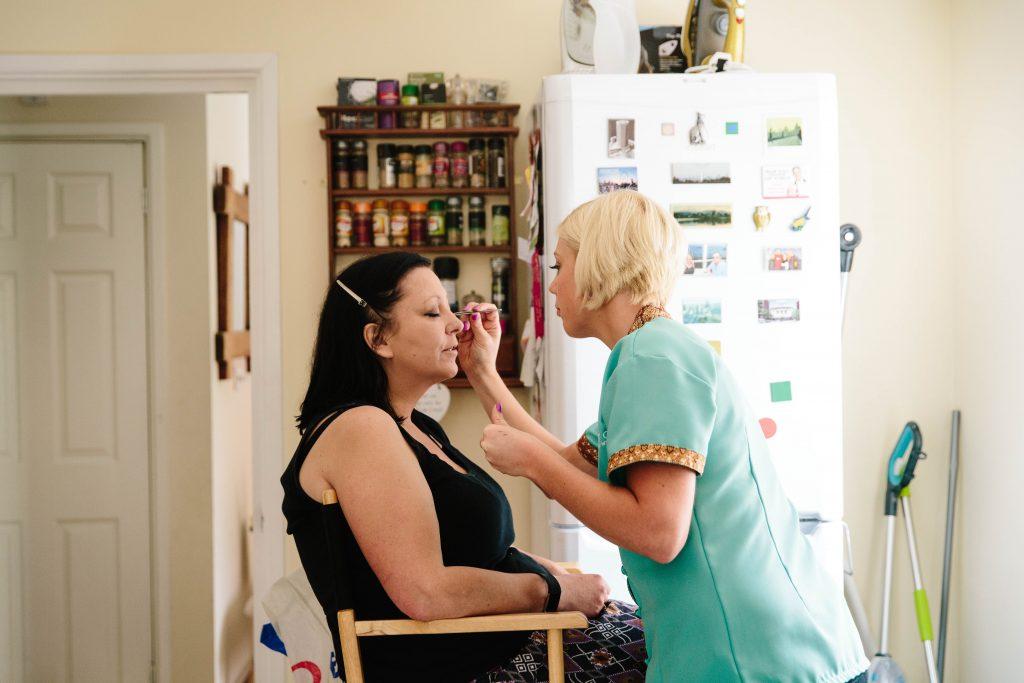 Bride having her wedding makeup done
