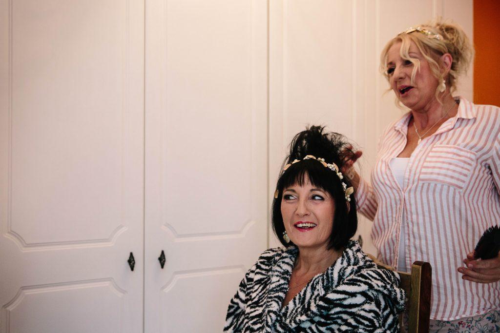 bridesmaids laughing at backcombed hair