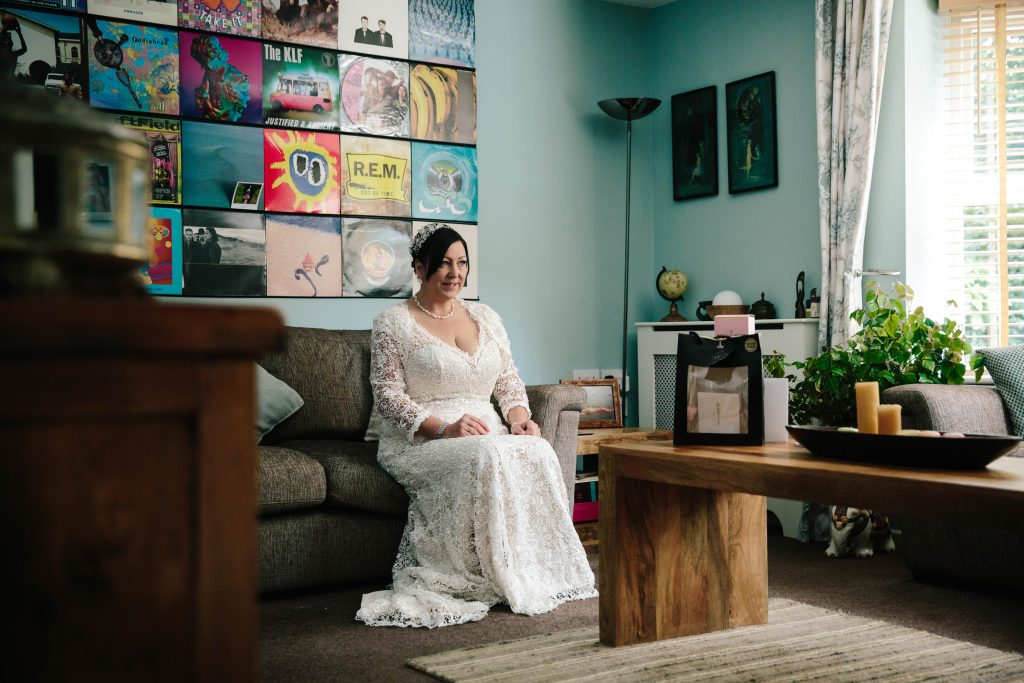 bride sitting in lounge, waiting to go to her wedding