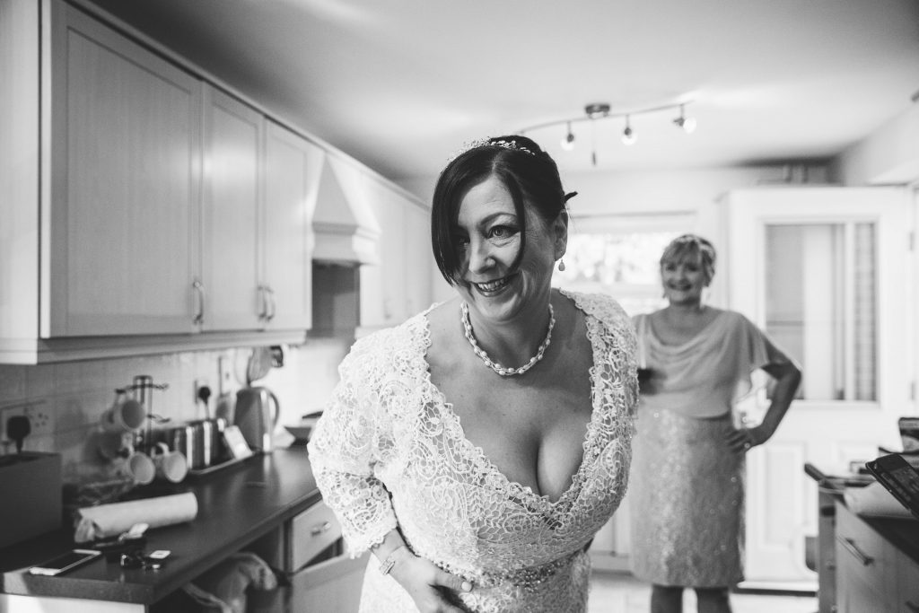 black & white image of bride laughing