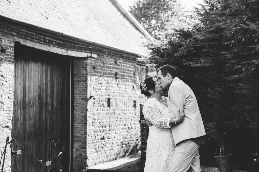 Bride & Groom kissing at Dovecote Barn