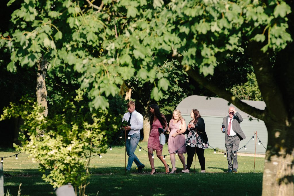 Guests walking to the tipi for wedding reception at Dovecote Barn