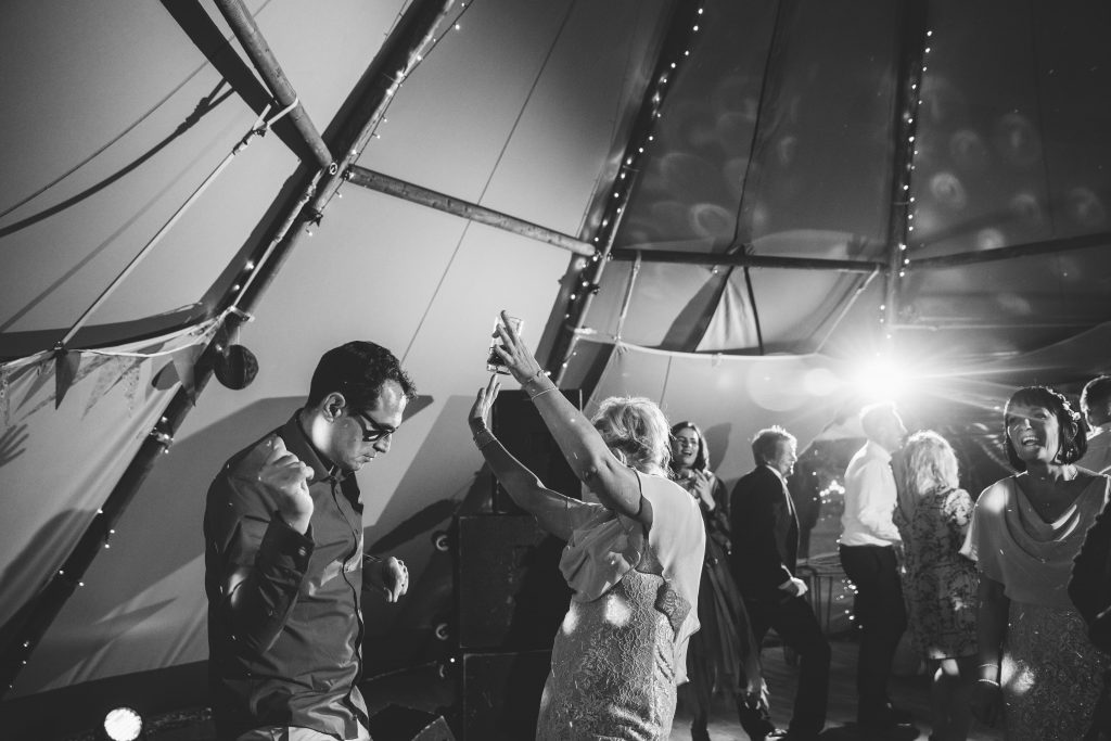 guests dancing, black & white image