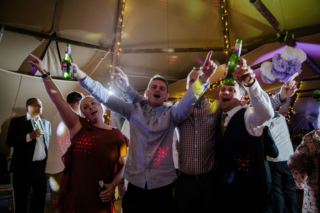 guests on the dancefloor, tipi wedding