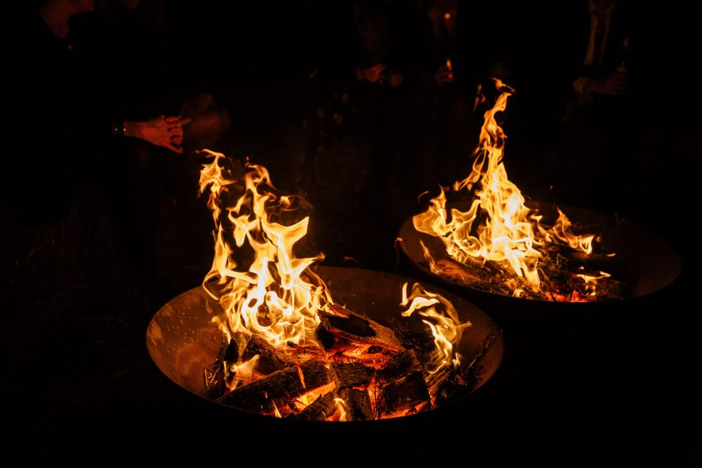 fire pit at an outdoor wedding