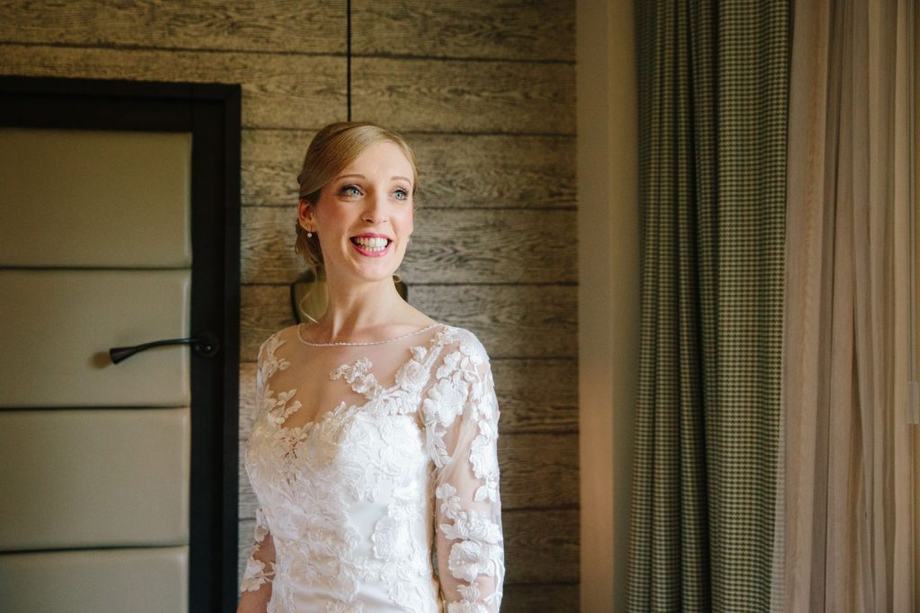 Bride smiling looking radiant in her wedding dress