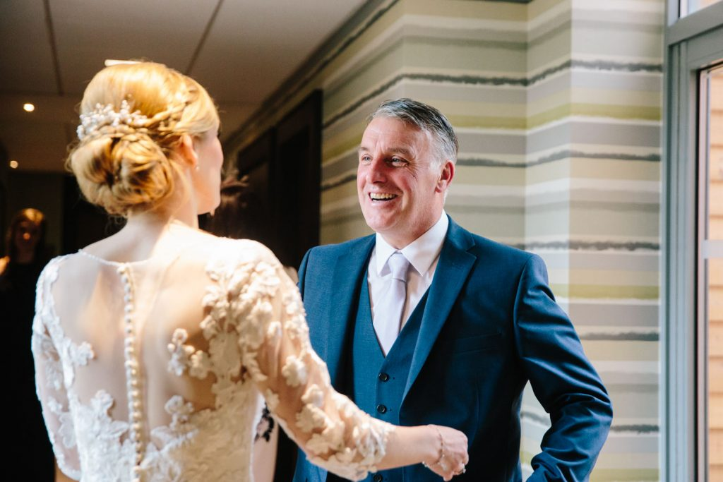 Dad seeing bride for the first time in her wedding dress at the Warwickshire golf club