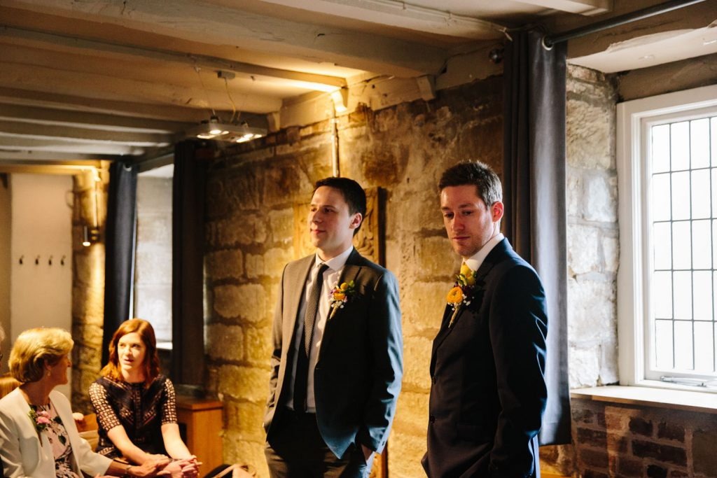 Groom and Best man waiting for the Bride to enter the wedding ceremony at the Saxon Mill