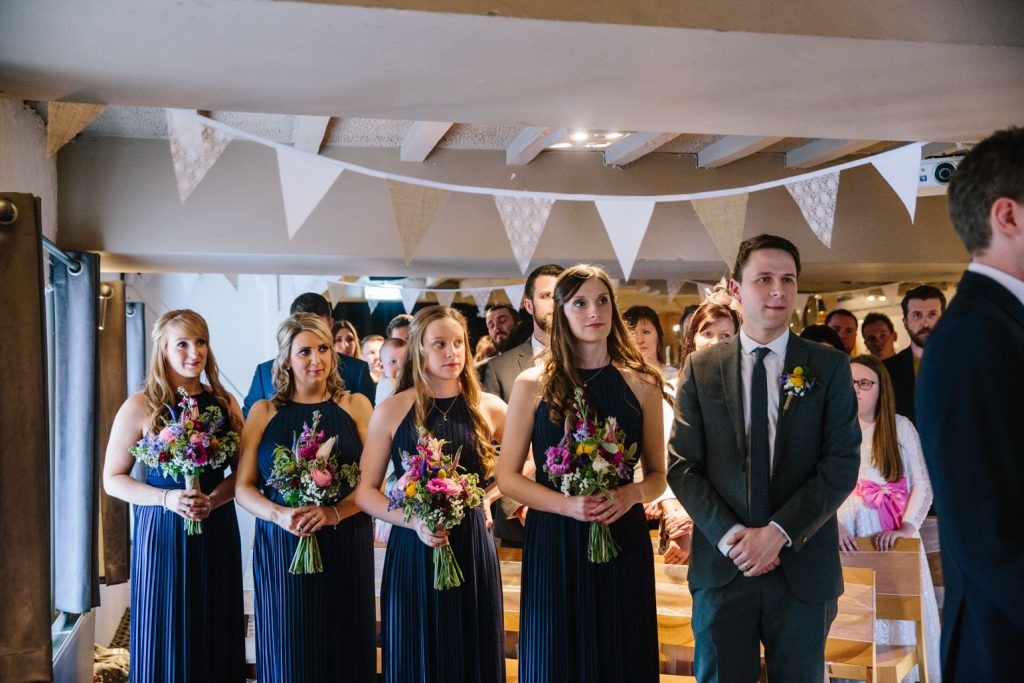 Bridesmaids and Best man during the wedding ceremony at the Saxon Mill