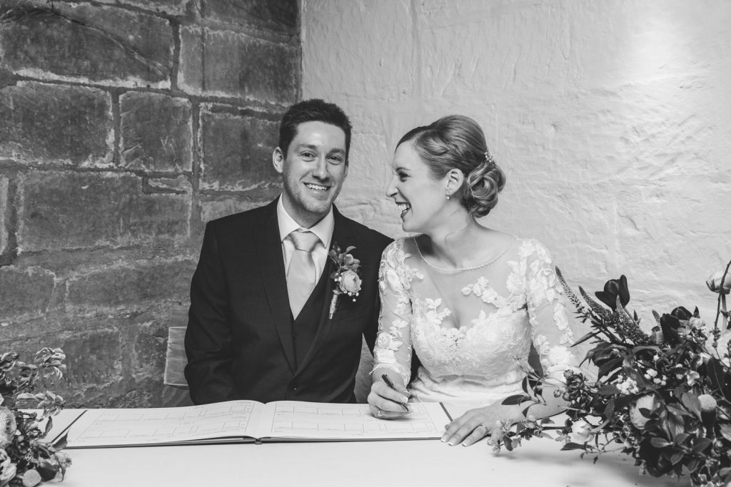 Bride & Groom signing the register at The saxon Mill wedding