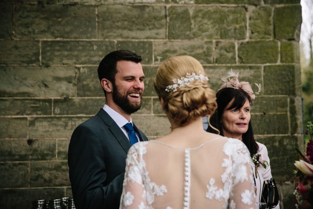 guest laughing at Saxon Mill wedding