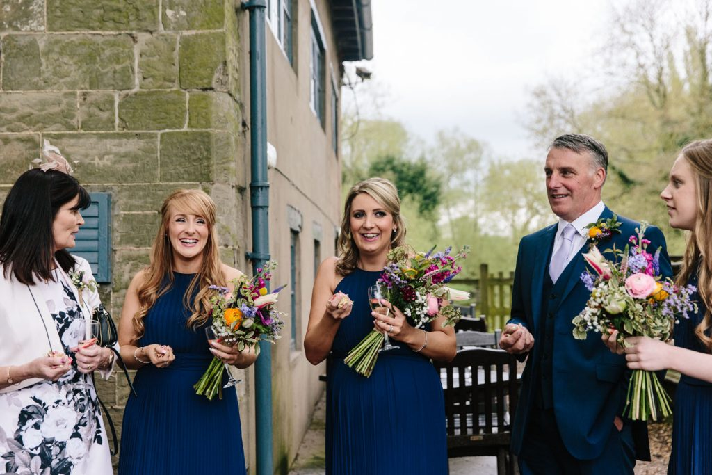 Bridesmaids and Father of bride ready to throw confetti, Saxon Mill wedding