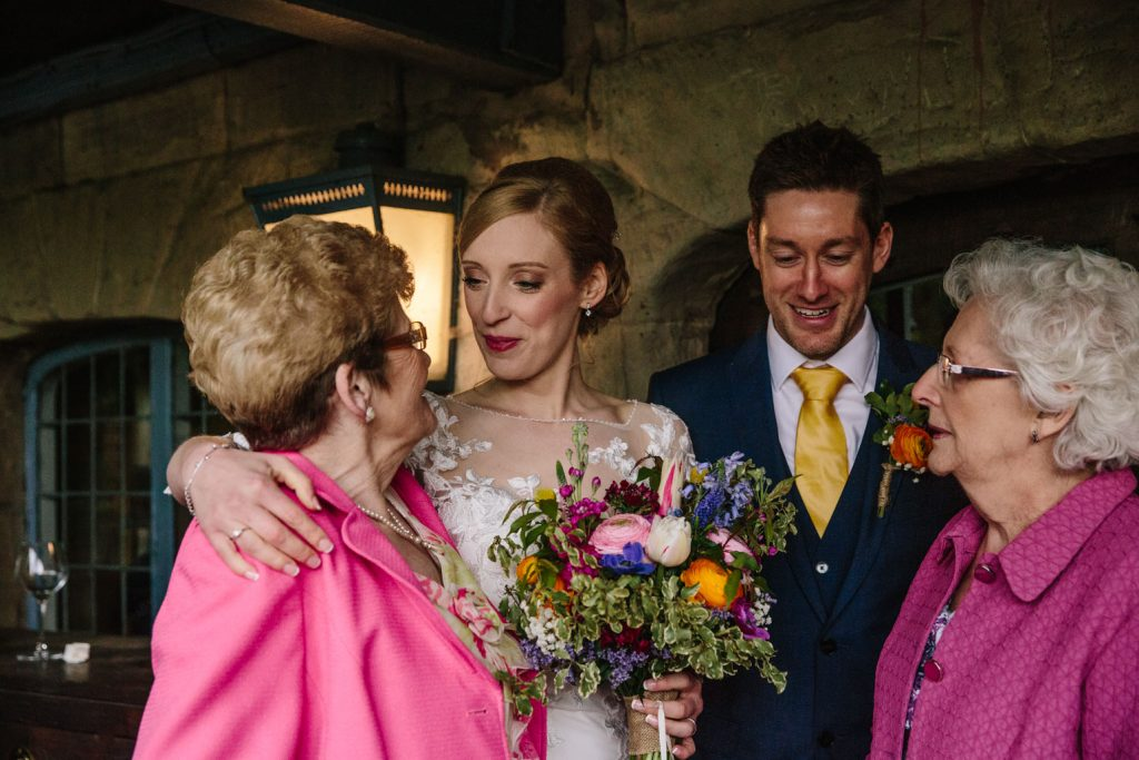 Bride and groom with Nan's at their wedding at the Saxon Mill